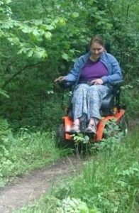 Anna test driving a potential new chair 196x300 - KFA Test Team 'Walk for Wheels' for Anna